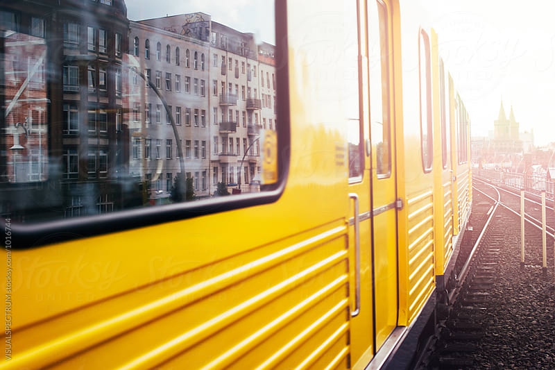 Berlin - Yellow Subway Train With Oberbaum Bridge in Background by Julien L. Balmer for Stocksy United