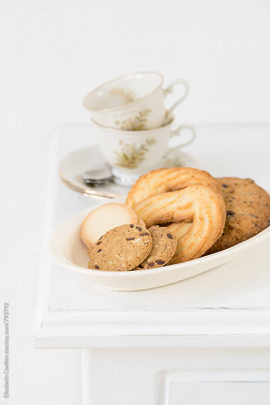 Tea time with cookies by Elisabeth Coelfen for Stocksy United