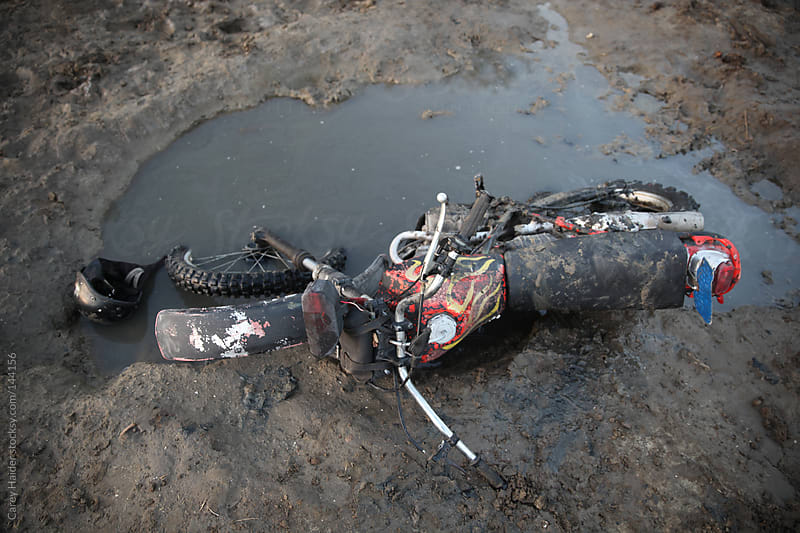 A Dirt Bike Motorcycle Stuck In A Mud Puddle by Carey Haider for Stocksy United