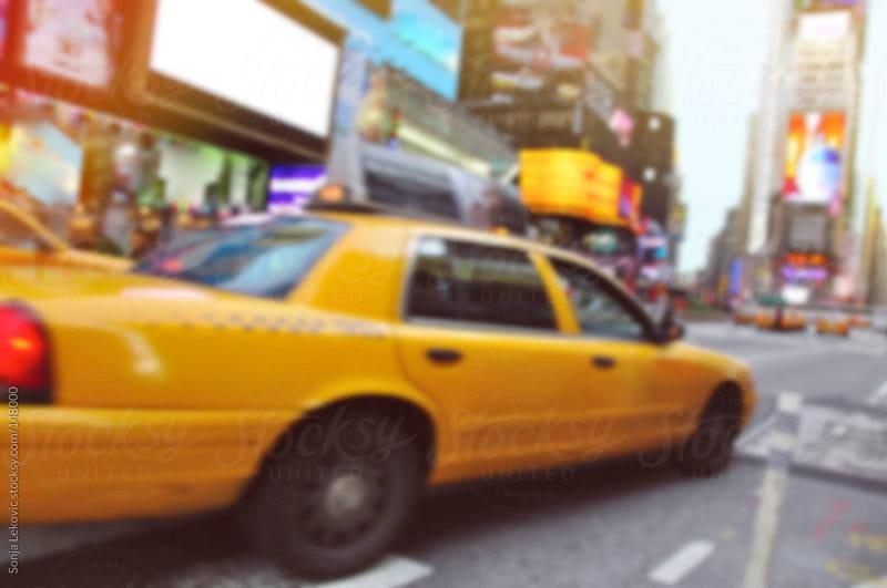new york city cab defocused by Sonja Lekovic for Stocksy United