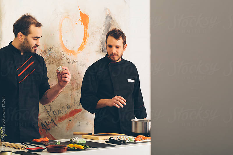 Chefs Tasting Sushi by VICTOR TORRES for Stocksy United