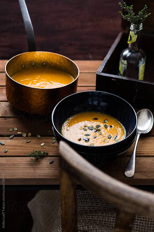 Butternut Squash Soup on a dark table by Aniko Lueff Takacs for Stocksy United