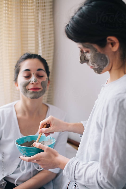 Two female friends having beauty treatment in their home  by Marija Mandic for Stocksy United