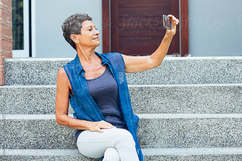 Senior Woman Takes a Selfie Outdoors by Lumina for Stocksy United