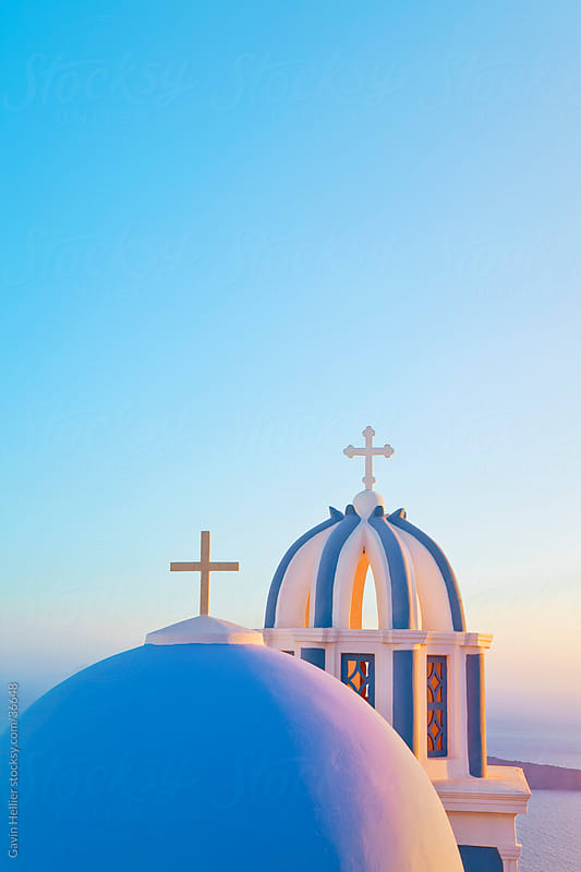 Bell Towers of Orthodox Church overlooking the Caldera in Fira, Santorini (Thira), Cyclades Islands, Aegean Sea, Greece, Europe by Gavin Hellier for Stocksy United