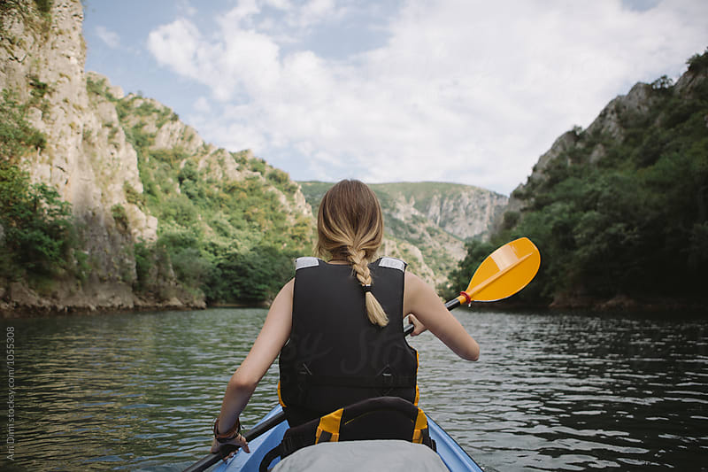 Woman kayaking by Ani Dimi for Stocksy United