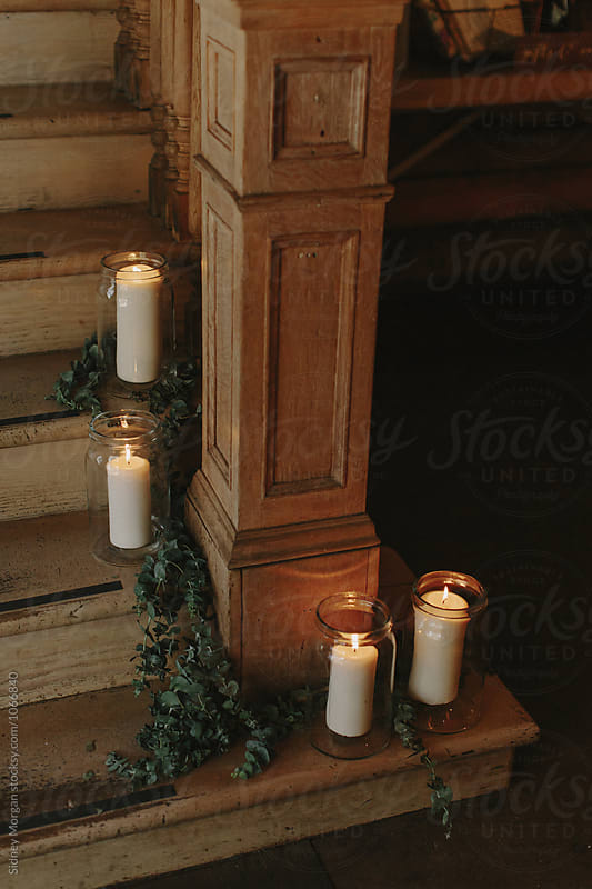 Candles sitting on Stairs by Sidney Morgan for Stocksy United