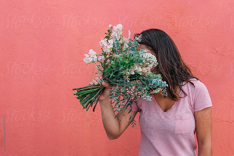 woman with a bouquet of flowers by Micky Wiswedel for Stocksy United