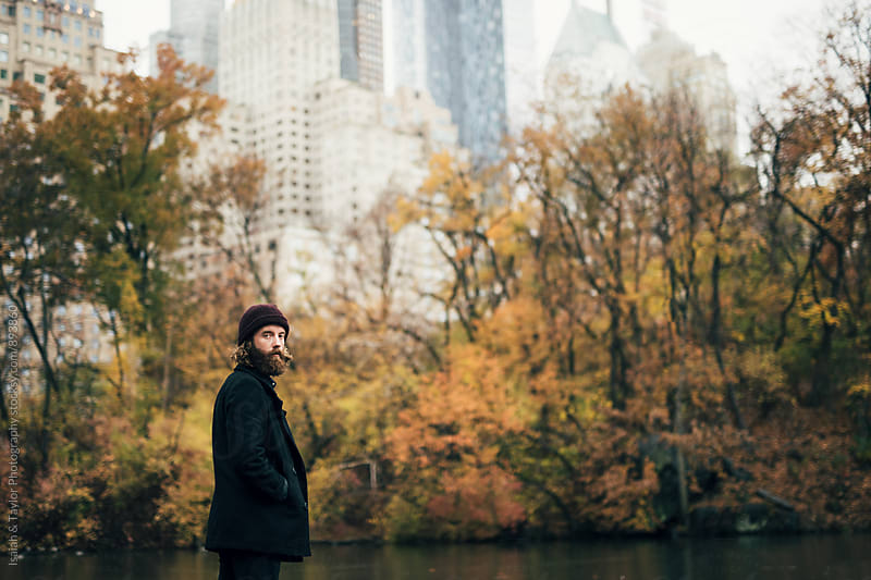 Man alone in Central Park by Isaiah & Taylor Photography for Stocksy United