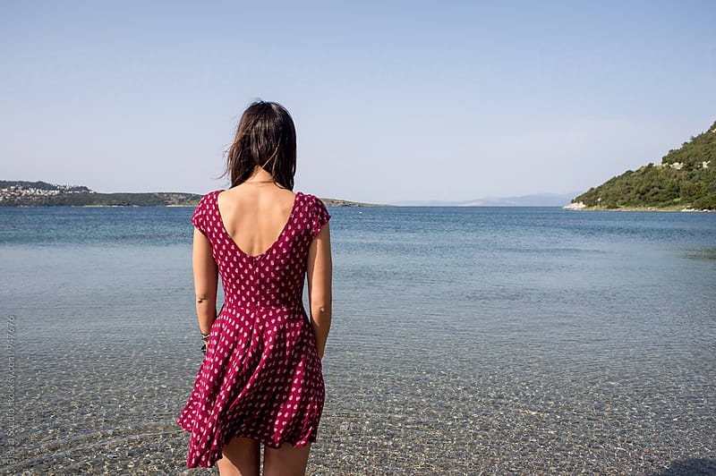 Beautiful woman gazing at the Aegean Sea by Bisual Studio for Stocksy United
