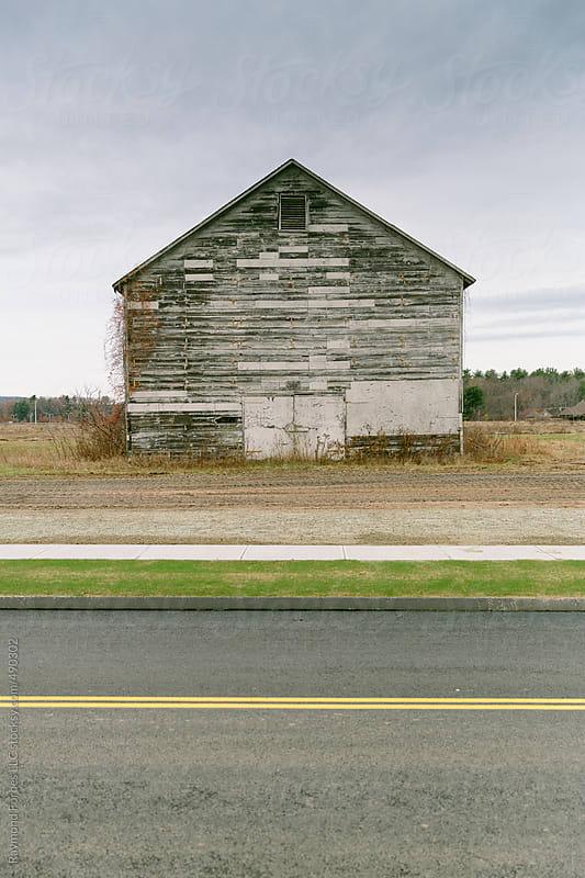 Urban Sprawl Encroaching Rural Connecticut Tobacco Farm by Raymond Forbes LLC for Stocksy United