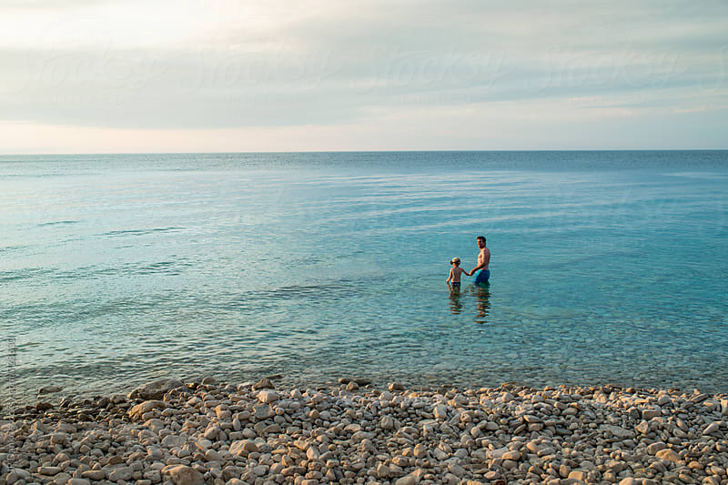 Faterh and Son Swimming in Cold Freshwater Georgian Bay Bruce Peninsula National Park by JP Danko for Stocksy United