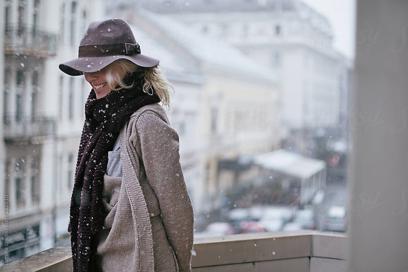 Happy Woman on a Snowy Day by Lumina for Stocksy United