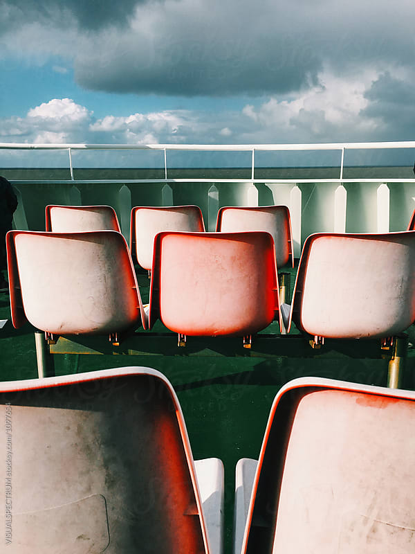 Empty Plastic Chairs on North Sea Ferry by VISUALSPECTRUM for Stocksy United