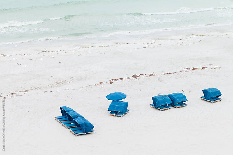 Blue cabanas at the beach by Amanda Worrall for Stocksy United