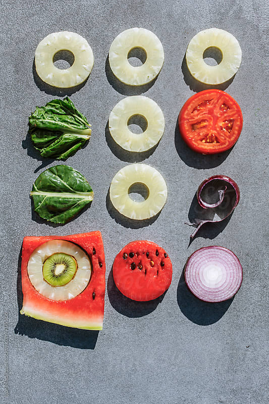 Standard, colorful fruits and vegetables, cut into a circle by Igor Madjinca for Stocksy United