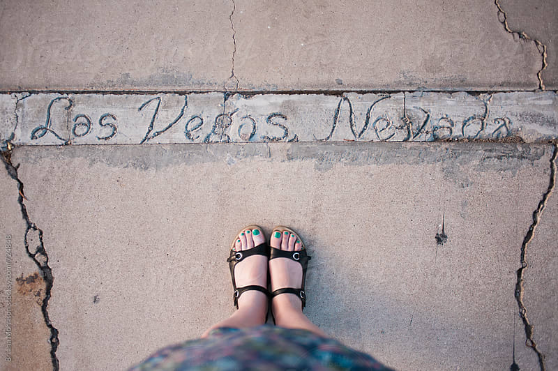 Woman's Feet Standing Next to a Handwritten Las Vegas, Nevada Sign in Cement by Briana Morrison for Stocksy United
