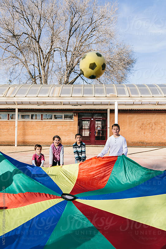 Children Playing at the School with a Colorful Tent by VICTOR TORRES for Stocksy United