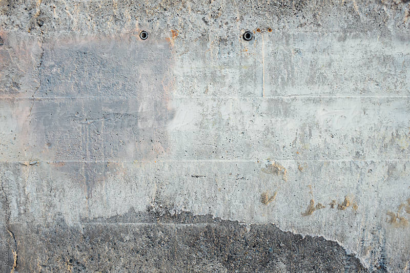 Detail of old paint covering cement wall  by Paul Edmondson for Stocksy United