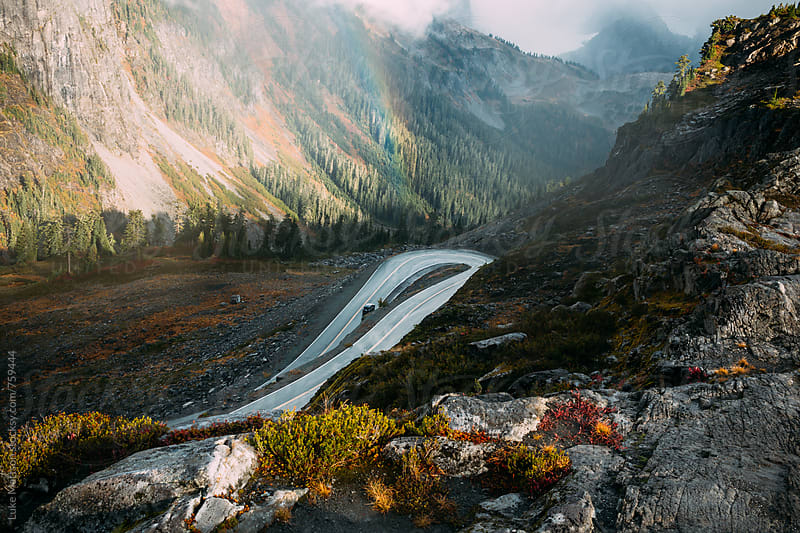 Hairpin Turn Along Highway On Rocky Mountainside  by Luke Mattson for Stocksy United