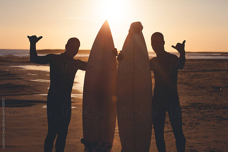 Couple of surfers with surf boards by Leandro Crespi for Stocksy United