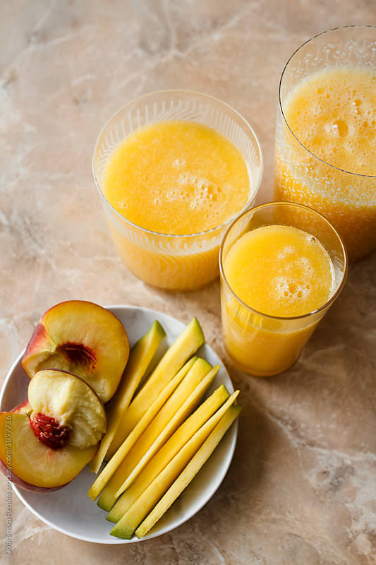 Mango and peach smoothie by Dobránska Renáta for Stocksy United