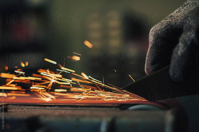Belt Sander Sparks by L&S Studios for Stocksy United
