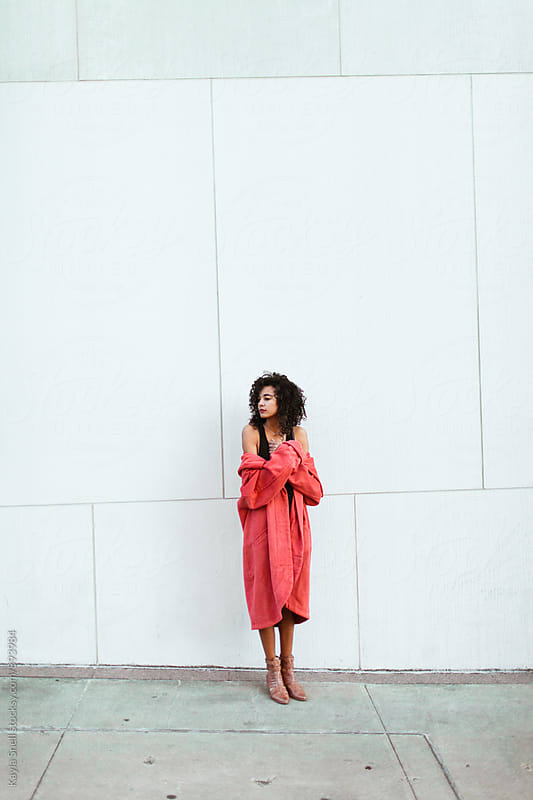 Young woman in a pink coat by Kayla Snell for Stocksy United