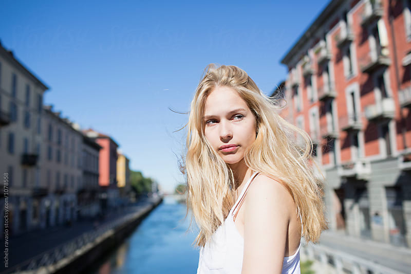 Beautiful girl alone around the city in summer by michela ravasio for Stocksy United