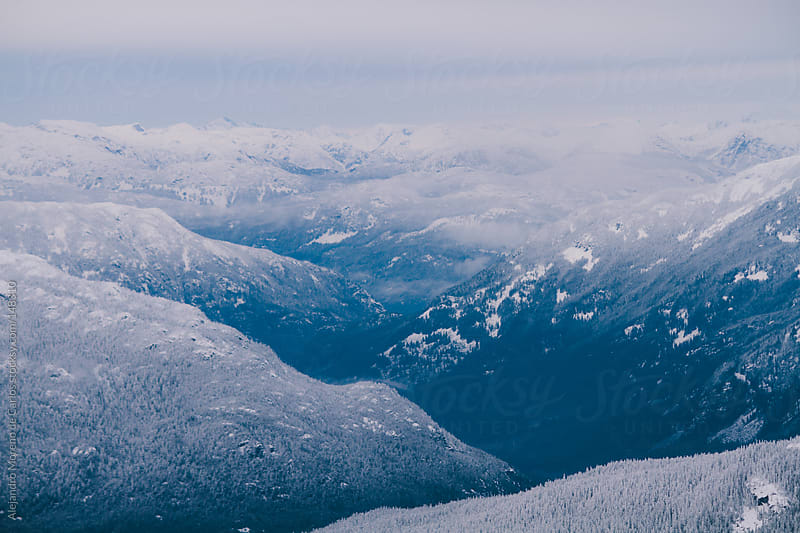Blue mountains with snow. Winter scene by Alejandro Moreno de Carlos for Stocksy United