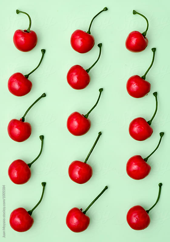 fake cherries by Juan Moyano for Stocksy United