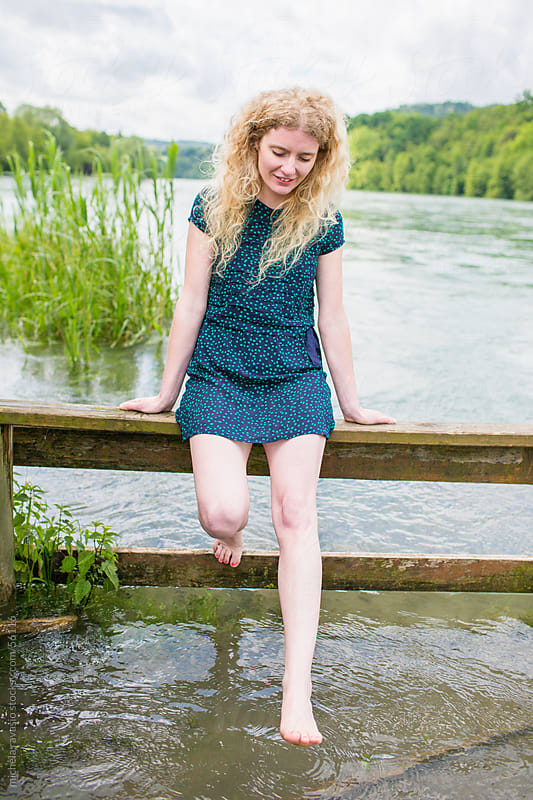 Woman enjoying the river by michela ravasio for Stocksy United