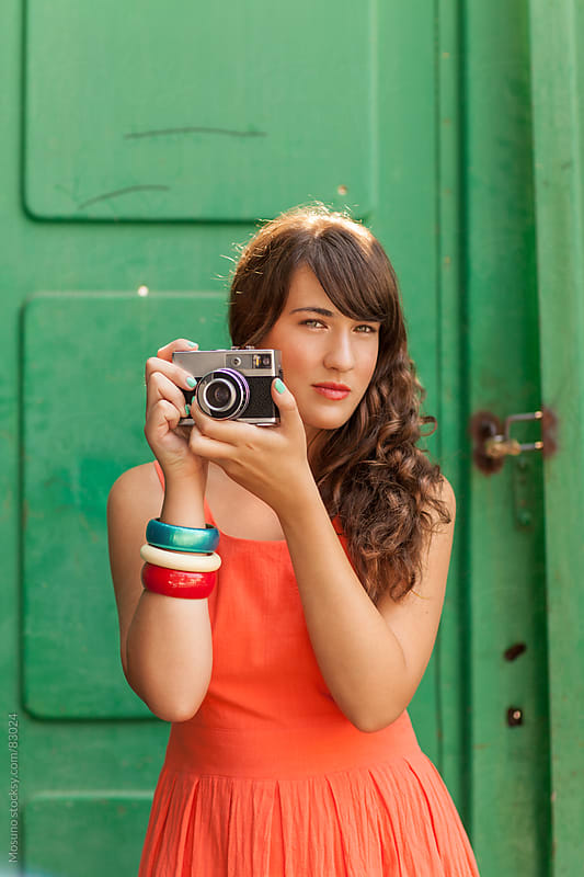 Woman taking pictures with retro camera. by Mosuno for Stocksy United
