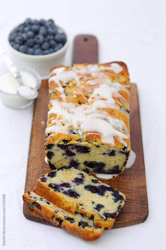 Loaf of blueberry bread by Daniel Hurst for Stocksy United