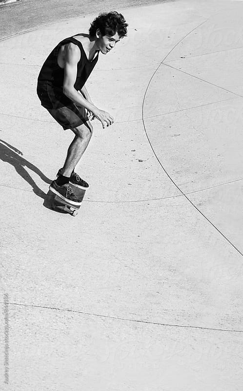 Young urban male driving skateboard. by Audrey Shtecinjo for Stocksy United