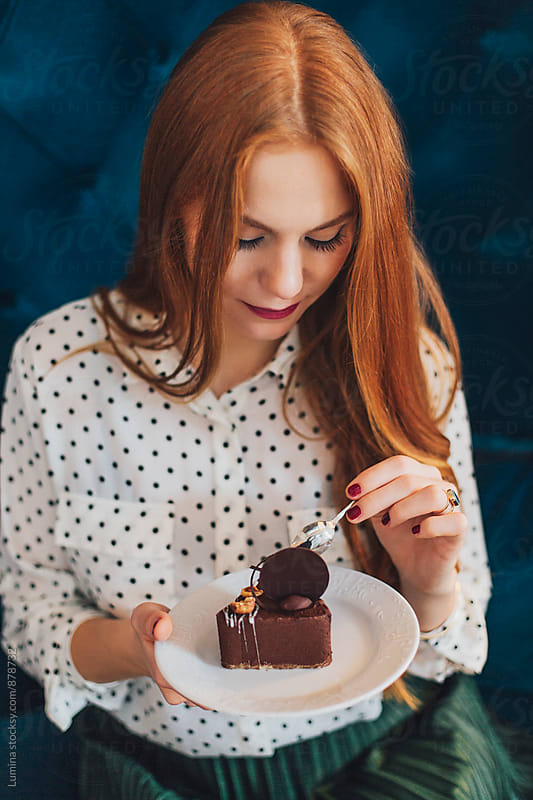 Ginger Woman Eating Chocolate Cake by Lumina for Stocksy United