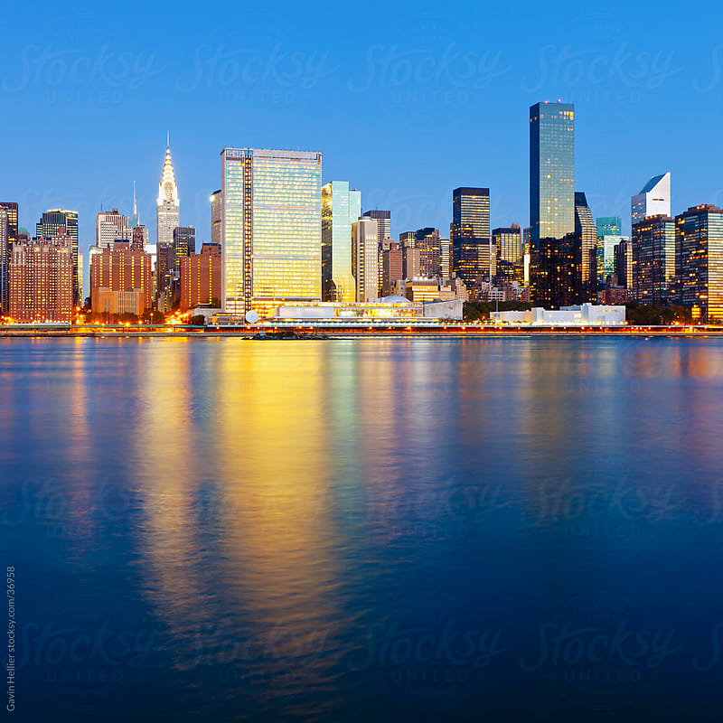 Skyline of Midtown Manhattan seen from the East River showing the Chrysler Building and the United Nations building, New York, United States of America  by Gavin Hellier for Stocksy United