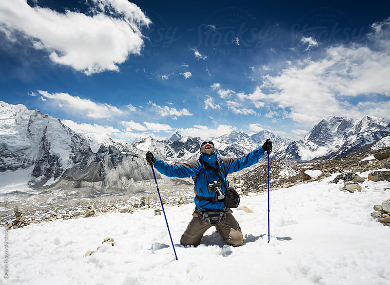 Mountaineer at the top of mountain by Dejan Ristovski for Stocksy United