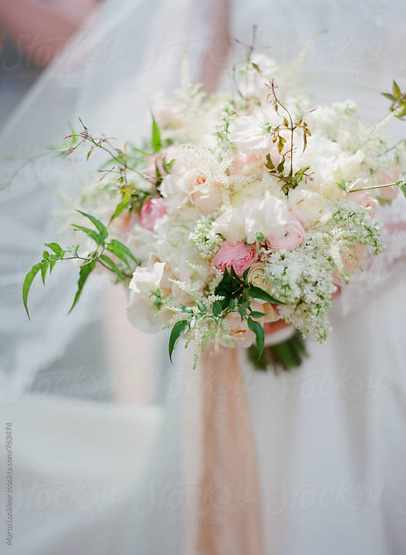 Delicate floral wedding bouquet by Marta Locklear for Stocksy United