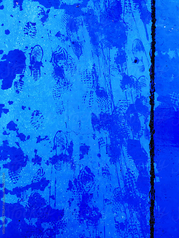 Wet Footprints of Shoes on Blue Background by VISUALSPECTRUM for Stocksy United
