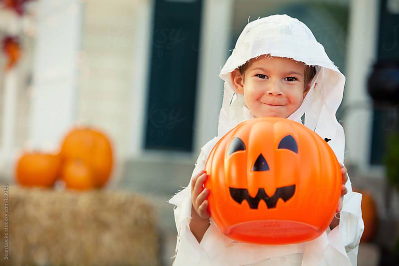Halloween: Little Boy With Candy Bucket by Sean Locke for Stocksy United