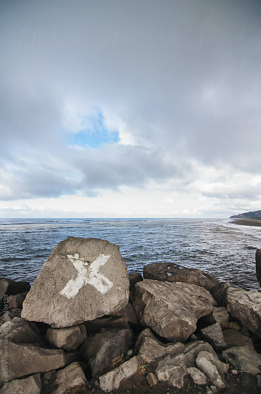 X marks the spot near the Pacific Ocean by Margaret Vincent for Stocksy United