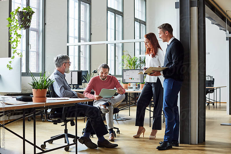 Business People Sharing Ideas In New Office