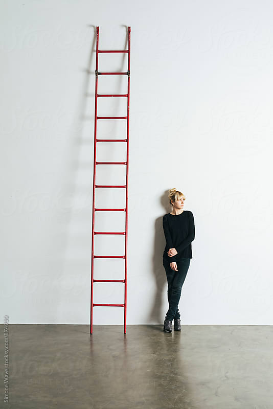 Woman and ladder by Simone Becchetti for Stocksy United