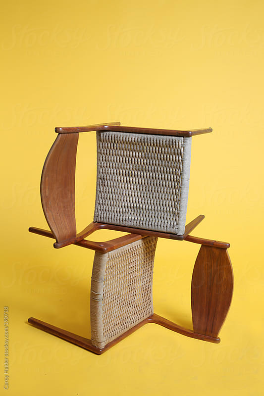 Mid Century Danish Chairs Against Yellow by Carey Haider for Stocksy United