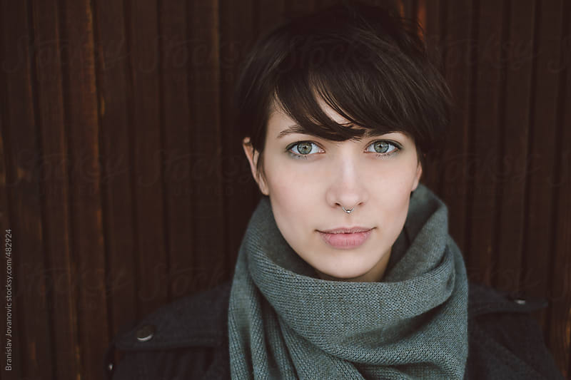 Portrait of a beautiful short-haired brunette at winter time by Brkati Krokodil for Stocksy United