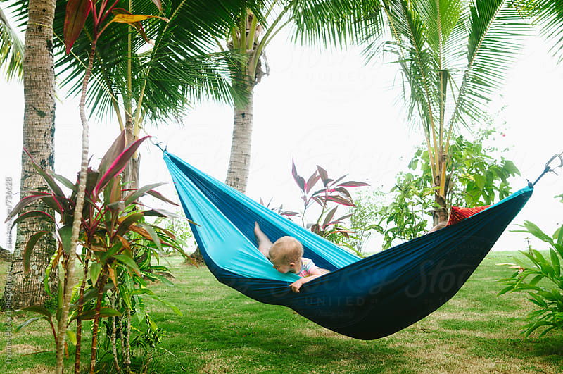 Toddler and mother in a hammock, Samoa. by Thomas Pickard for Stocksy United