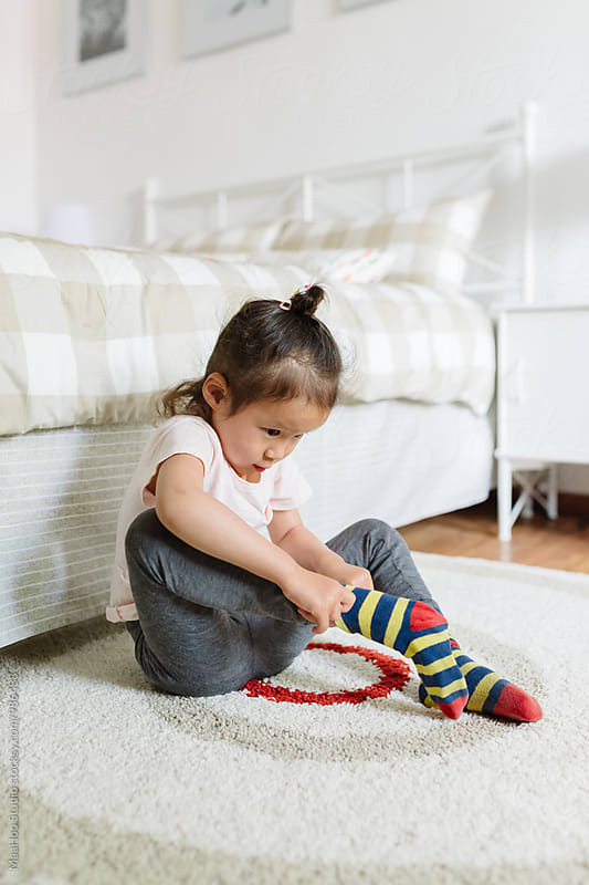 Portrait of girl wearing socks by MaaHoo Studio for Stocksy United