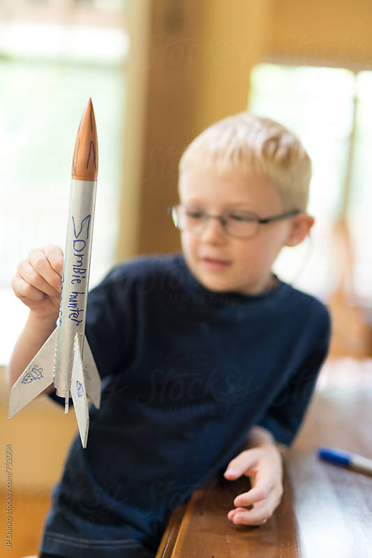 Creative Little Boy Rocket Scientist Showing Home Made Model Rocket Ready for Flight by JP Danko for Stocksy United