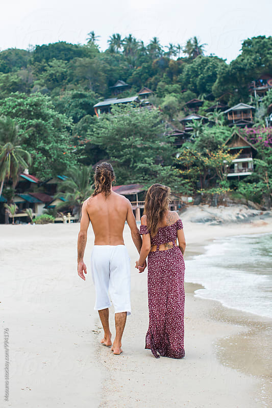 Anonymous Couple Walking Down the Beach by Mosuno for Stocksy United
